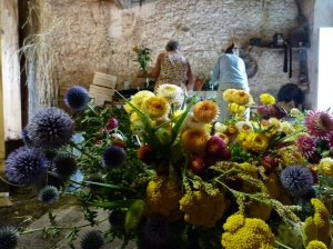 Preparing bouquets of flowers for the market